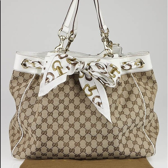 a15075e830b Gucci Handbags - Gucci Beige Ebony GG Canvas Positano Tote Bag